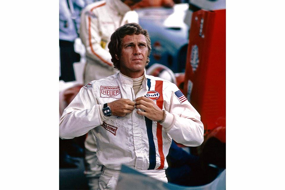 Steve McQueen in his racing outfit with the Monaco on the set