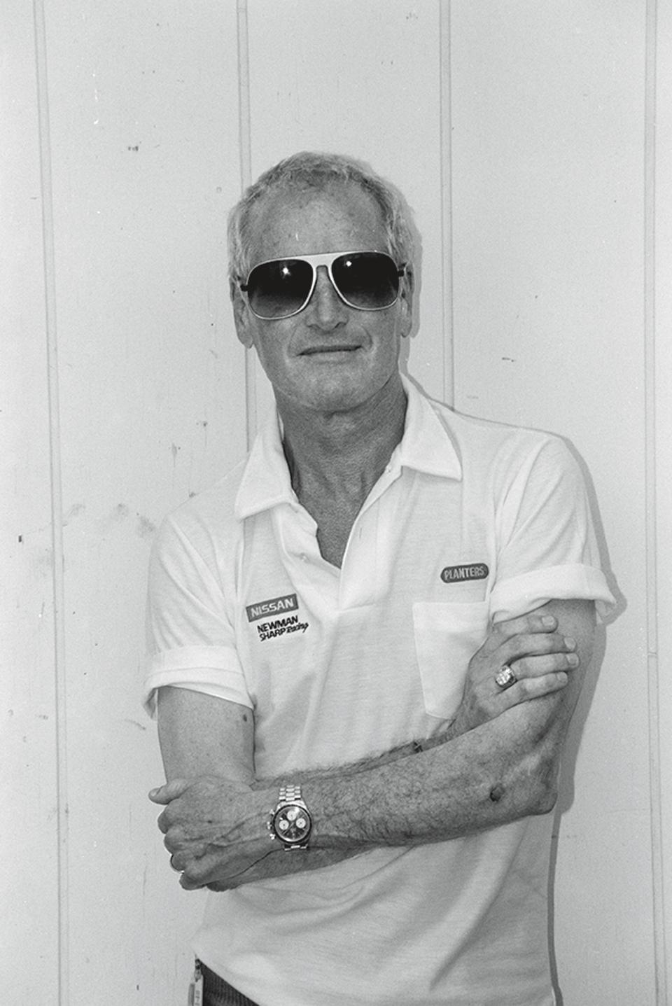 Paul Newman wearing his Rolex Daytona Big Red, coming up for sale at a Phillips auction.