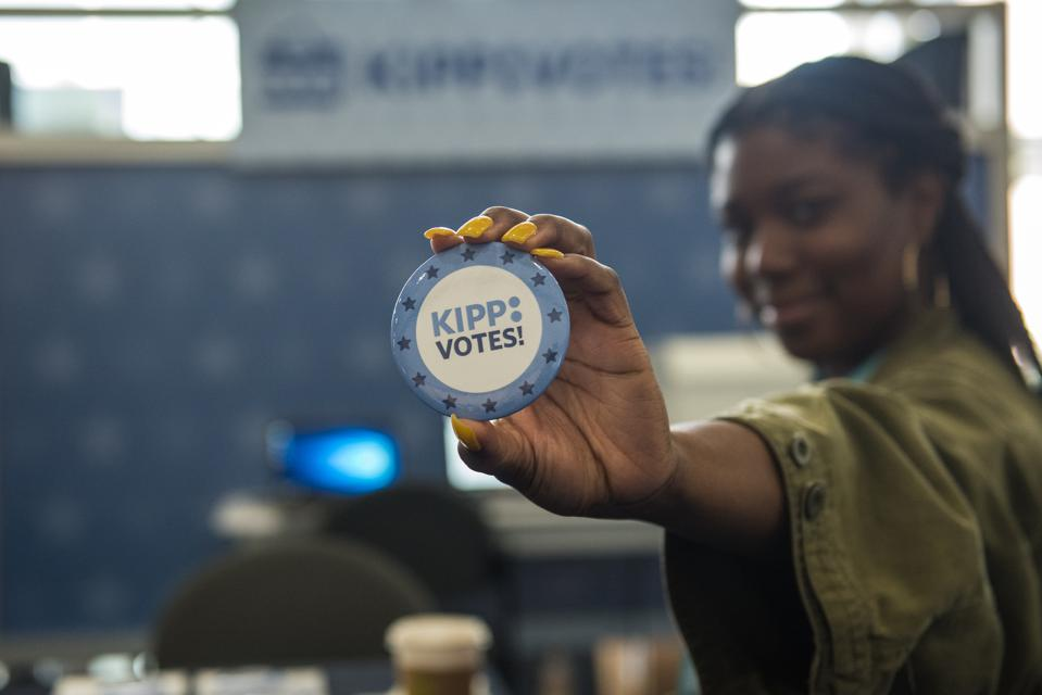 Photo shows a KIPP employee showing a KIPP Votes! button during the KIPP Schools Conference in July 2019.