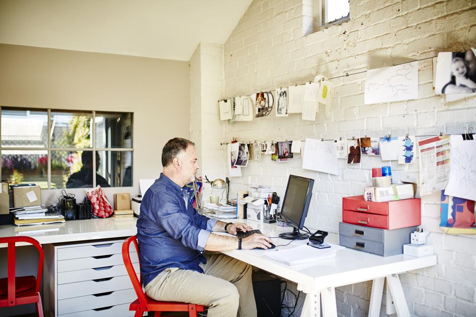 A man works from his home office