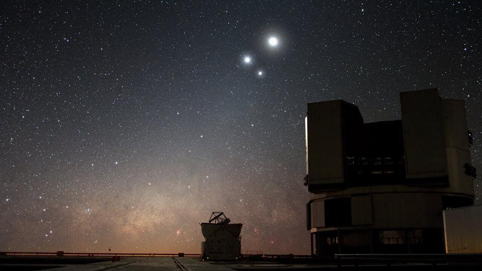 A 'triple conjunction' between Mercury, Jupiter and the Moon will dominate the post-sunset skies this week. Here's an image of Venus and Jupiter along with the Moon over ESO's Very Large Telescope (VLT) observatory at Paranal, Chile.