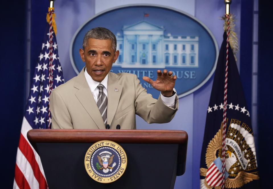 President Barack Obama wearing a tan suit (Photo by Alex Wong/Getty Images)