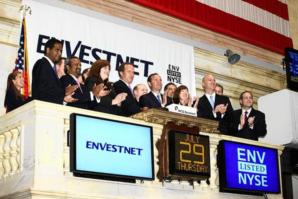 Envestnet co-founder Judson Bergman and Bill Crager ring the bell at the New York Stock Exchange to celebrate Envesnet's IPO.