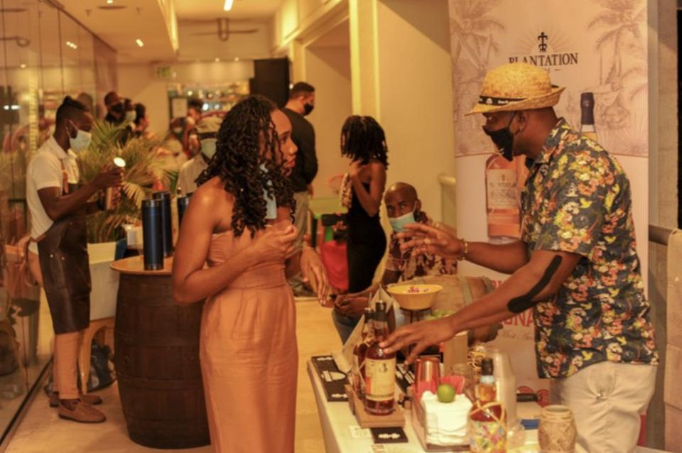 Mixologist Dameian Williams serves up rum delights at a Barbados Connect event.