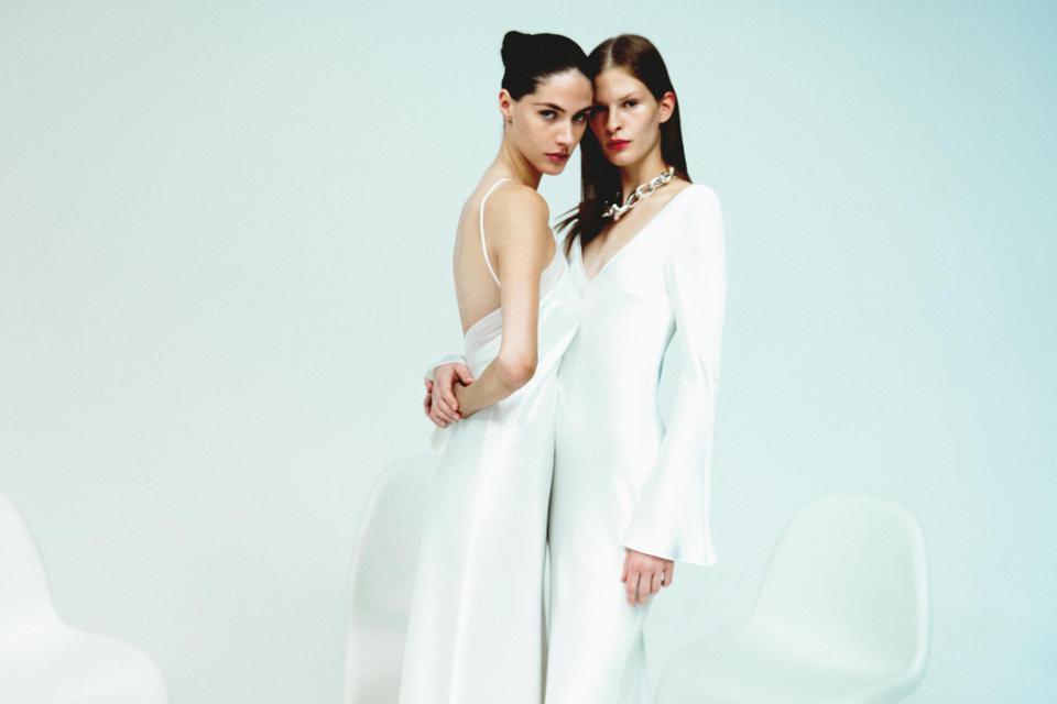 Two brides are both wearing looks from Galvan's new white collection, a bridal collection