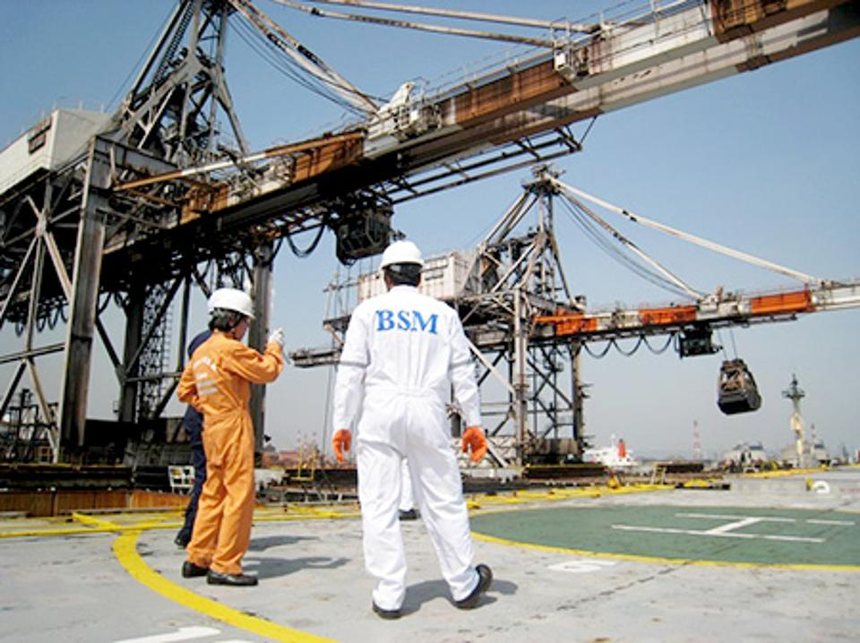Vessel inspection being conducted by MOL inspector, by the helipad of a large bulk carrier.