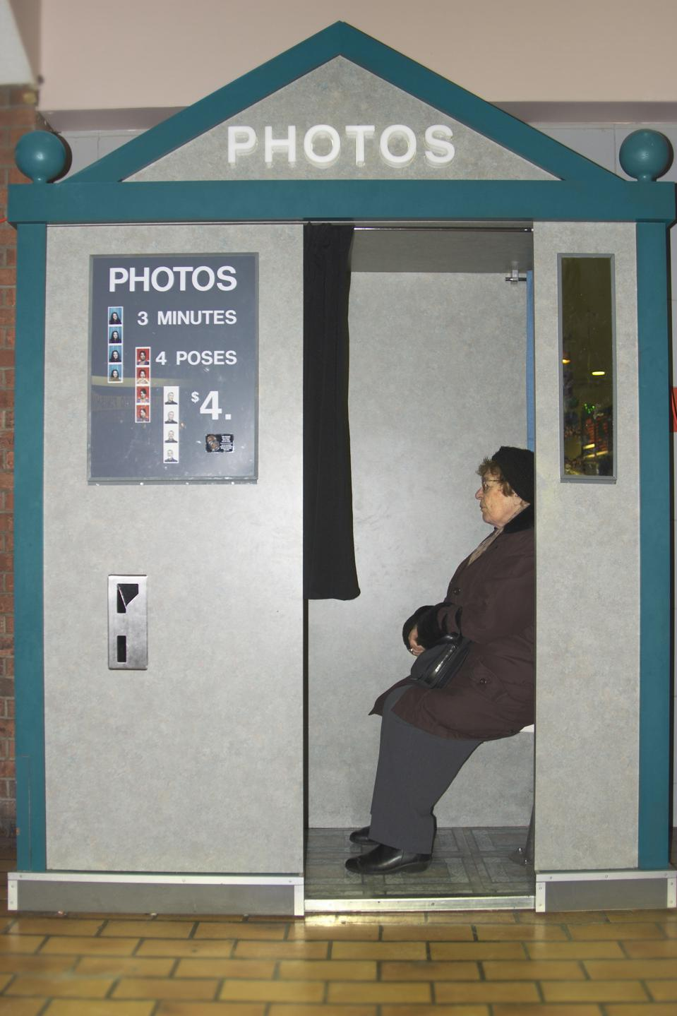 Woman Sitting in Photo Booth