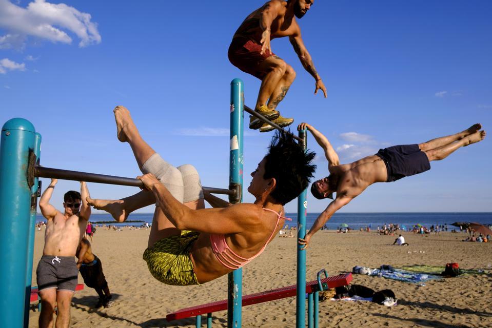 men doing beach gymnastics