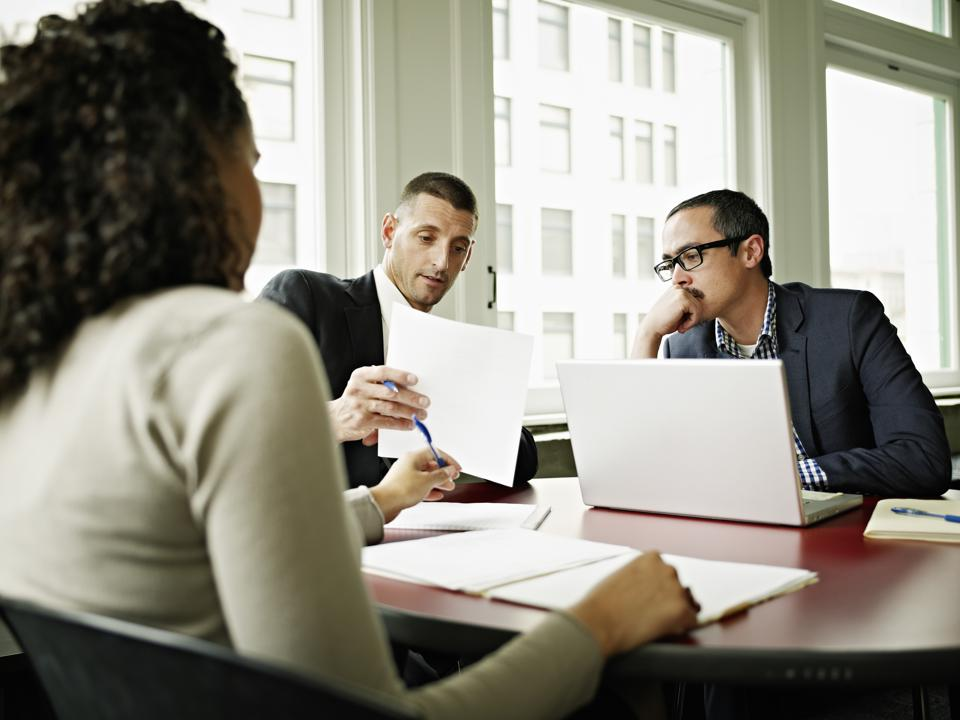 Coworkers in discussion in office conference room