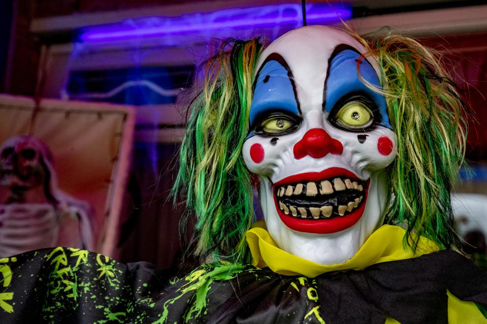 a Halloween clowns mask in a decorated front yard in Eindhoven, Netherlands