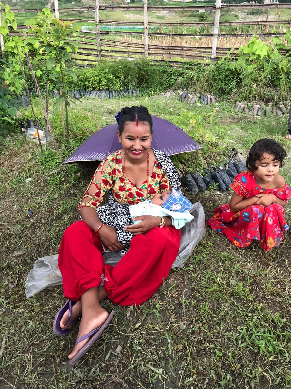 A Nepalese worker in the Sacred River Climate Project program and her two daughters.