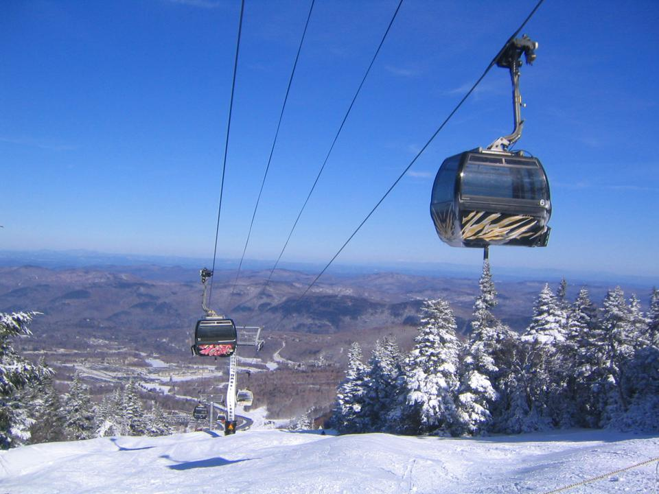 Cable cars over snowy mountain in a ski resort