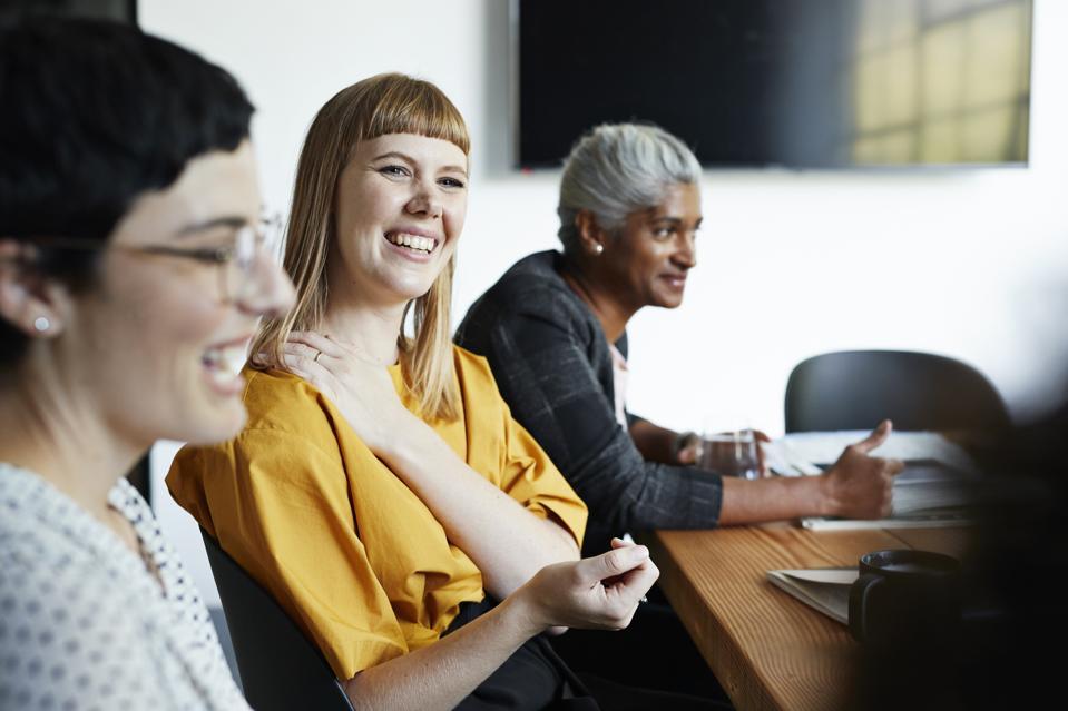 Entrepreneur with coworker in office meeting