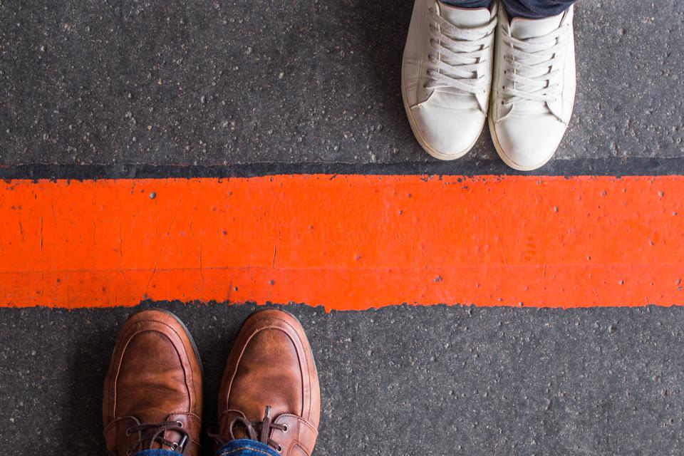 Man and woman divided by a line
