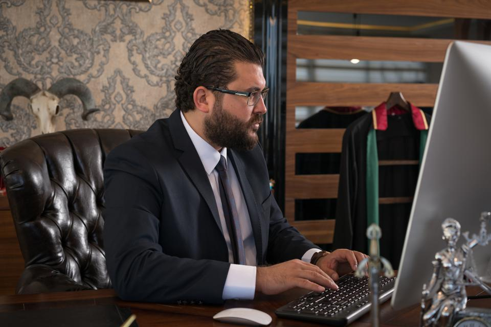 Caucasian businessman lawyer working while sitting in office