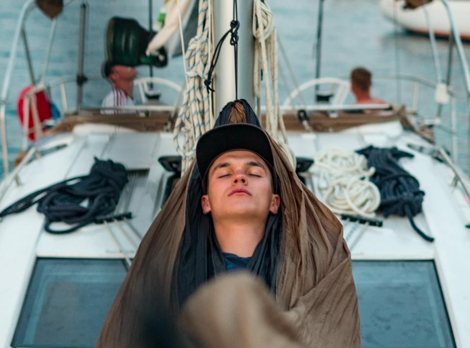 Young man sleeping on a boat