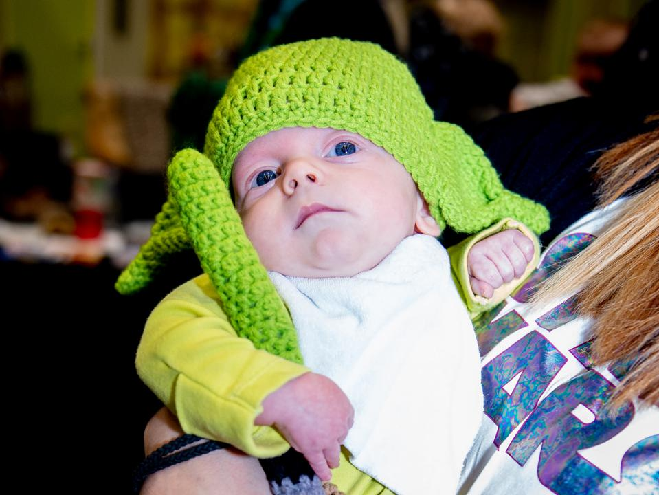 Baby cosplaying as Yoda at Comic Con Liverpool.