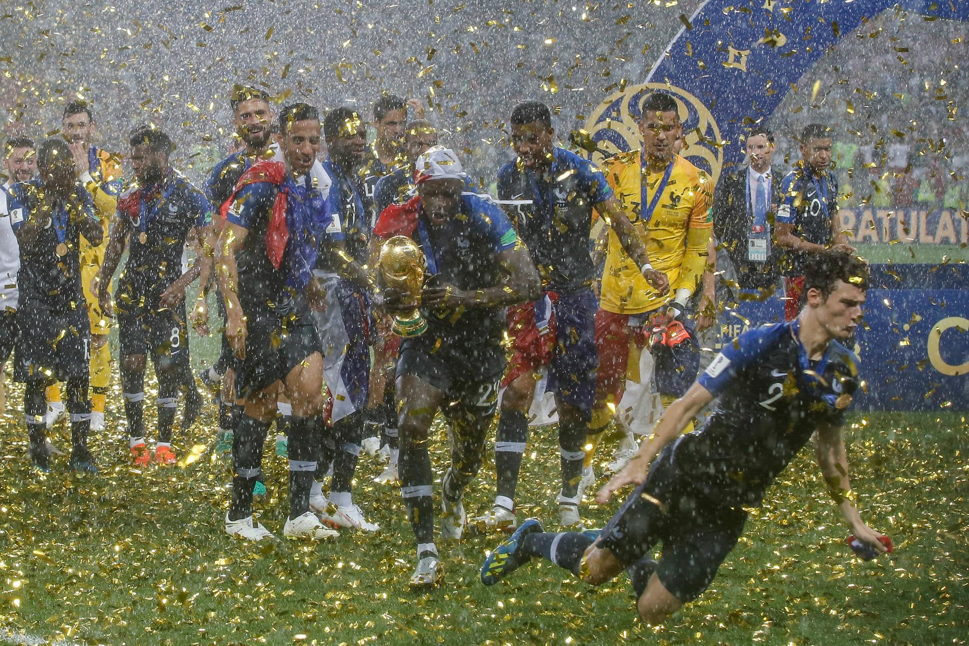 Players from France celebrate the 2018 World Cup title after...