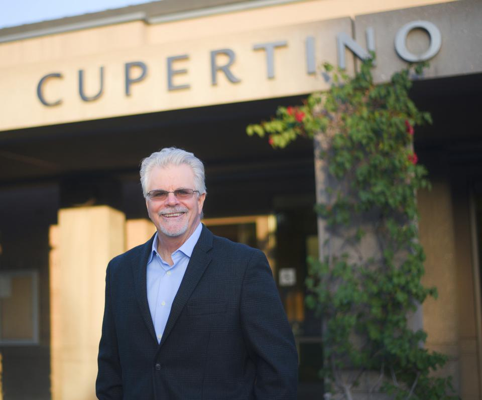 Bill Mitchell in front of Cupertino city hall.