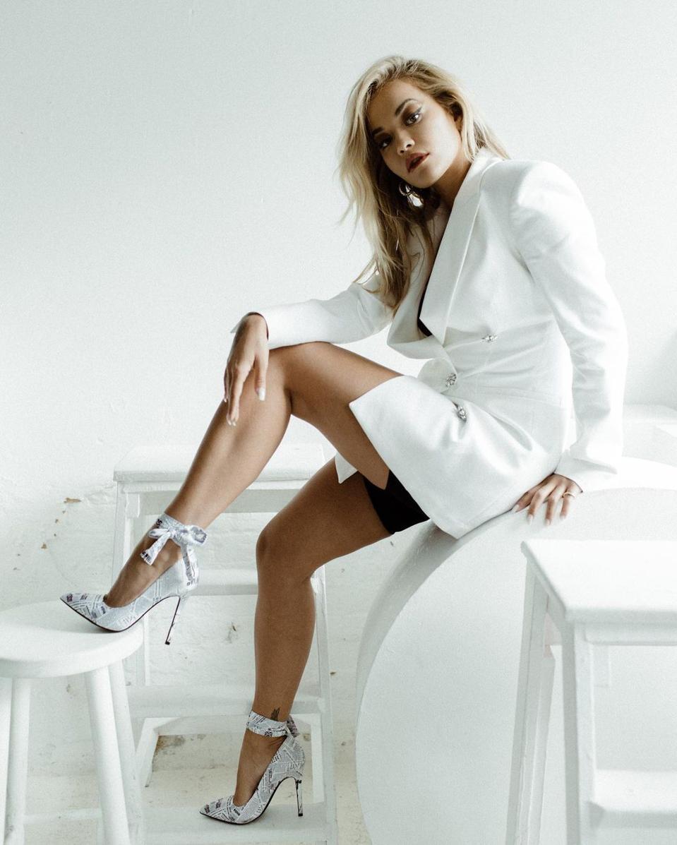 Rita Ora in an all-white ShoeDazzle look.