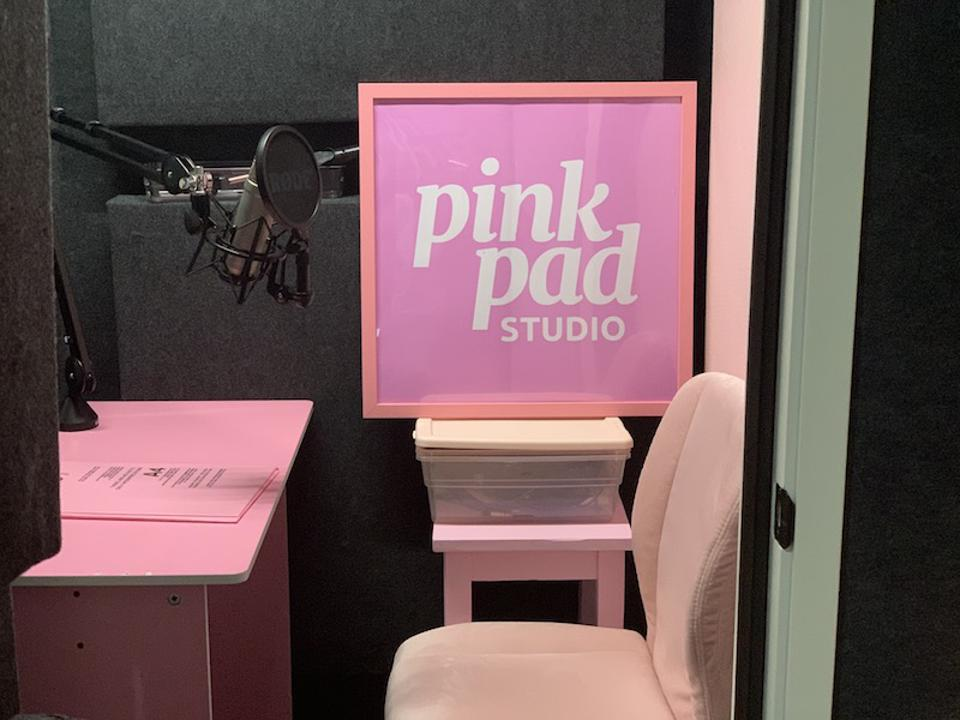 pink podcast studio with pink chair and pink desk