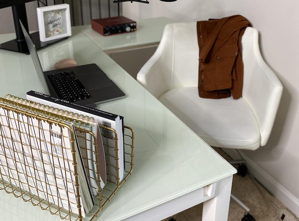 Home office with a white desk and white chair