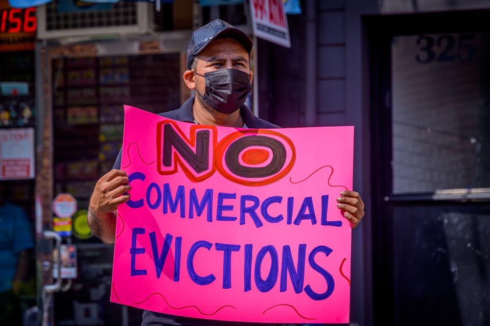 A Bushwick small business owner holding a sign at the rally...