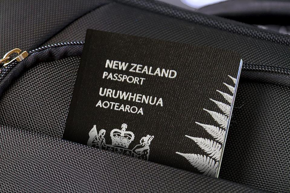 Close up of New Zealand Passport in Black Suitcase Pocket
