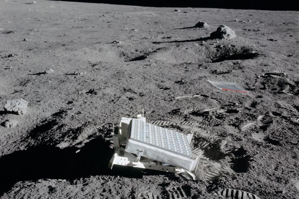 Black and white photo of retroreflector panel on the lunar surface.
