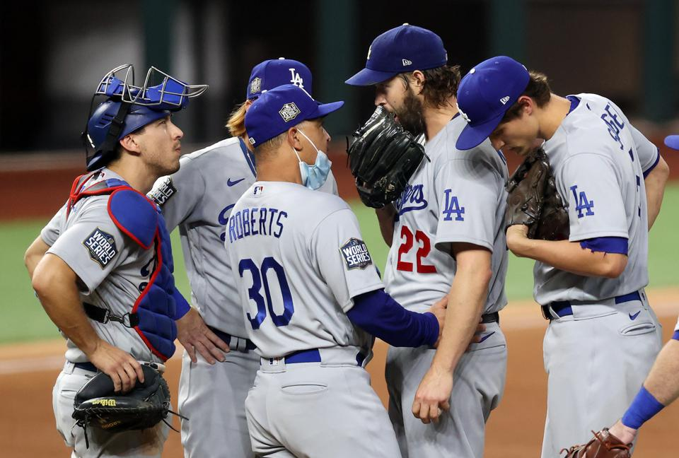 Dodgers manager Dave Roberts is pulling pitcher Clayton Kershaw from the ball game.
