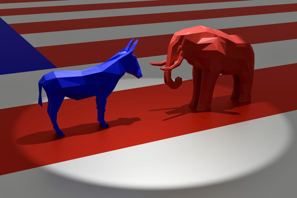 Democratic Blue Donkey and Republican Red Elephant in Spotlight on Top of American Flag
