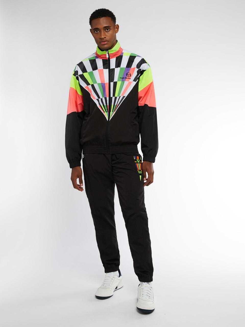 The two-piece nylon tracksuit set from Sergio Tacchini features a multicolor Camporese motif on the jacket and on the slim flit track bottoms.