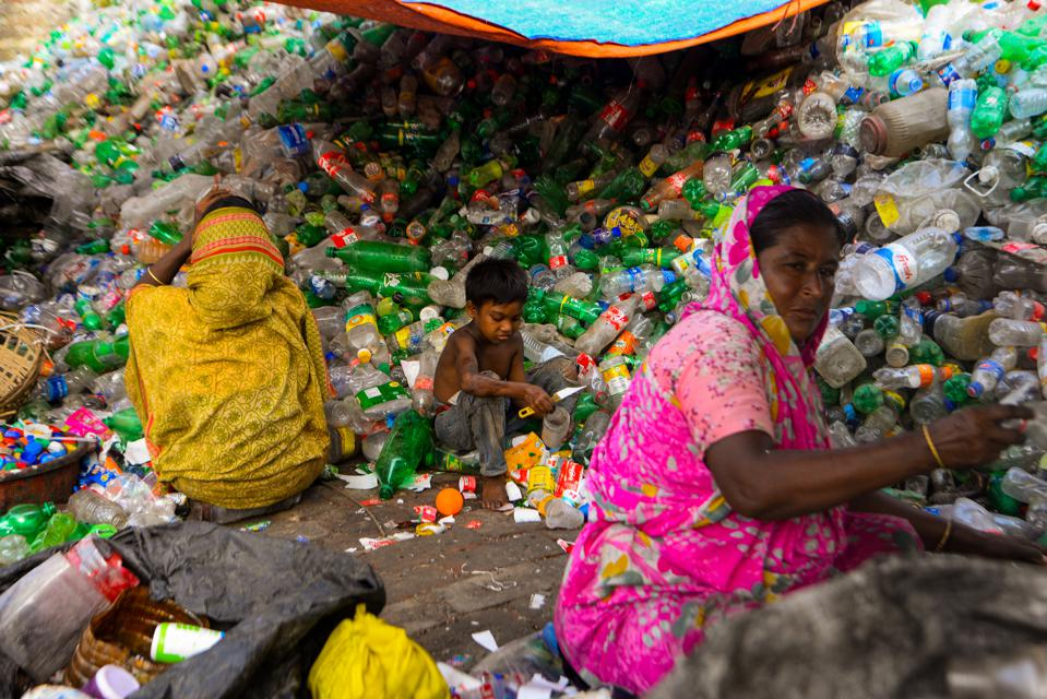 29 Sep 2020: Laborers seen working at a plastic bottle recycling factory in Dhaka, BANGLADESH