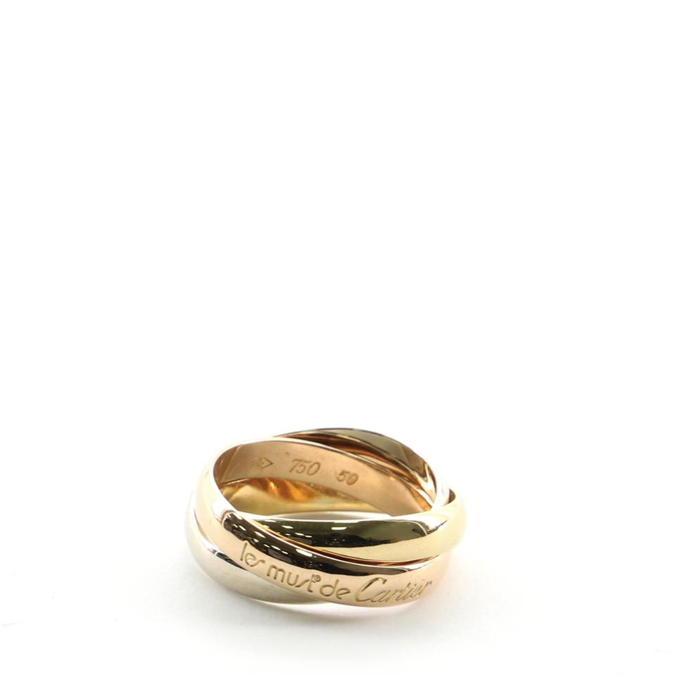 Cartier's Le Must de Cartier ring in rose, white and yellow gold is in demand.