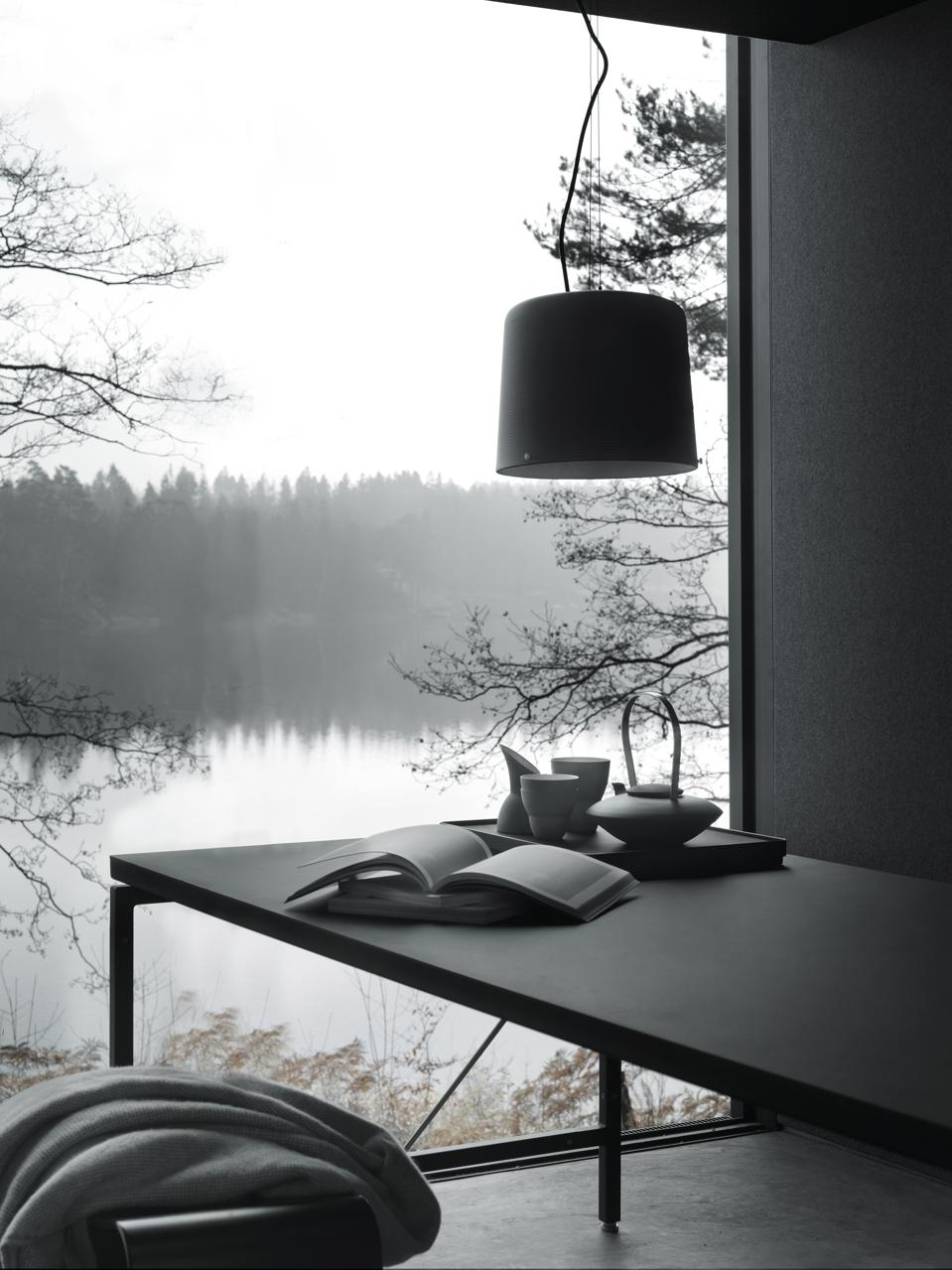 A key nook in the Vipp cabin overlooks a tranquil lake.