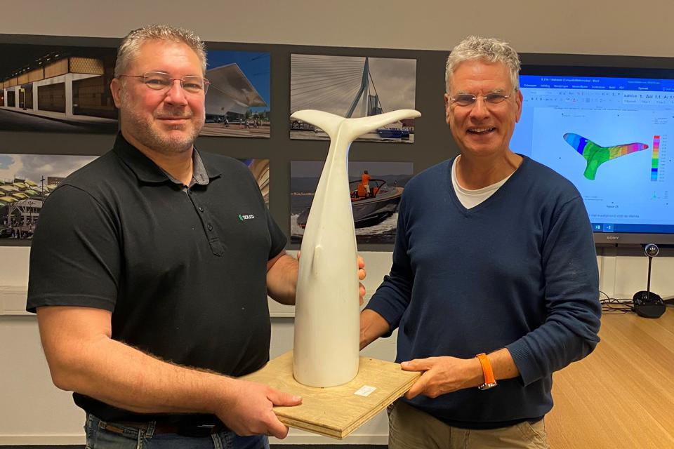 2 Nov: Peter Globevnik (L) and Hans Muller (R) with the 3D-printed sculpture of the whale tail sculpture that saved a train yesterday