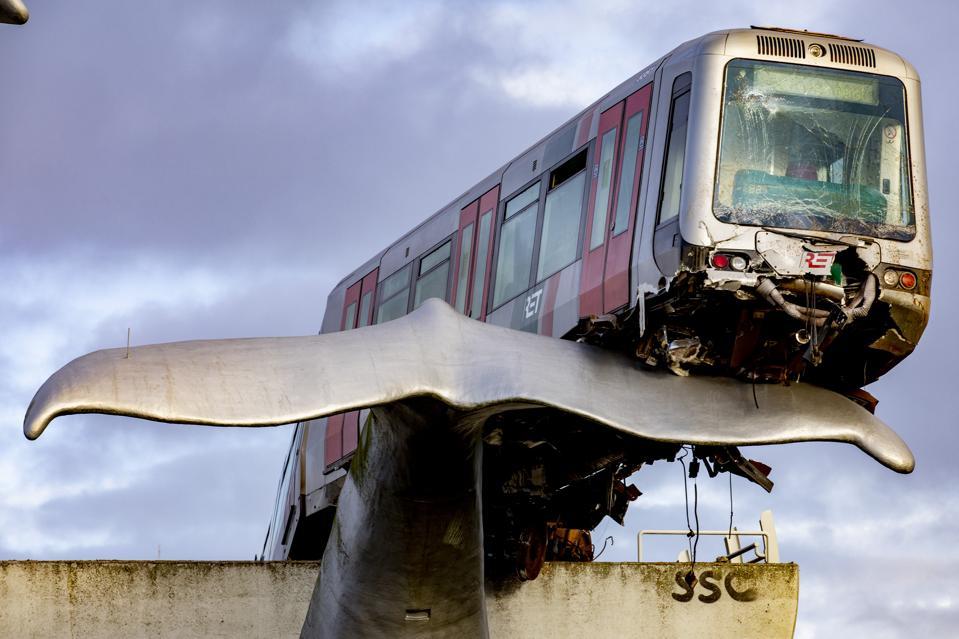 Subway train crashes and balances on whale statue