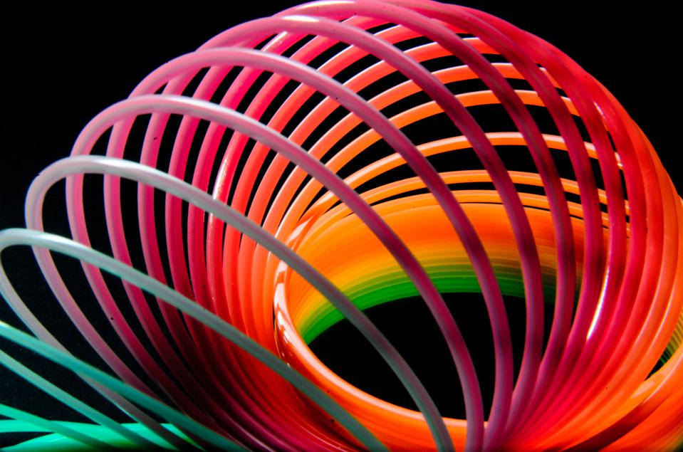Close-Up Of Colorful Slinky On Black Background