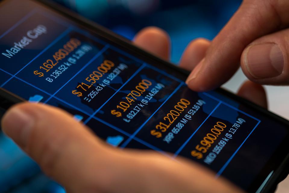 Trader checking financial statistics
