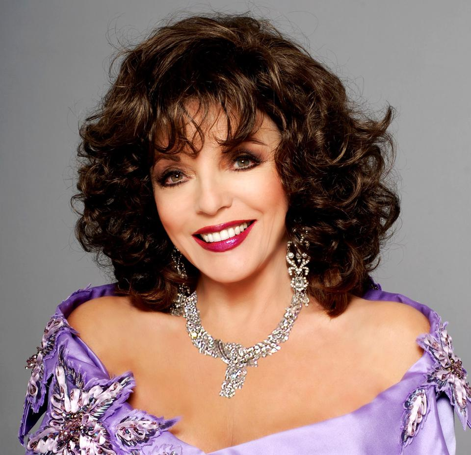 Joan Collins wearing the diamond necklace and earrings included in the auction at Bonhams