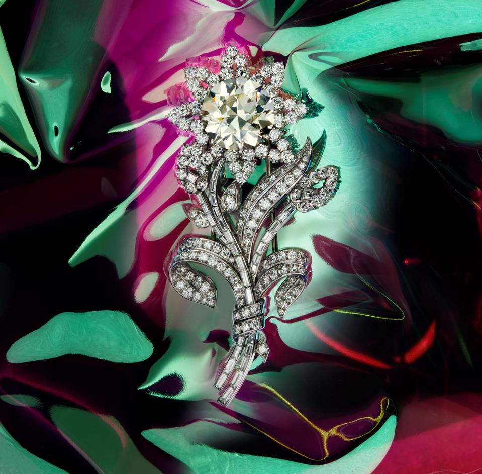 A diamond flower brooch, circa 1955, by Cartier with an estimate of $190,000 - $260,000