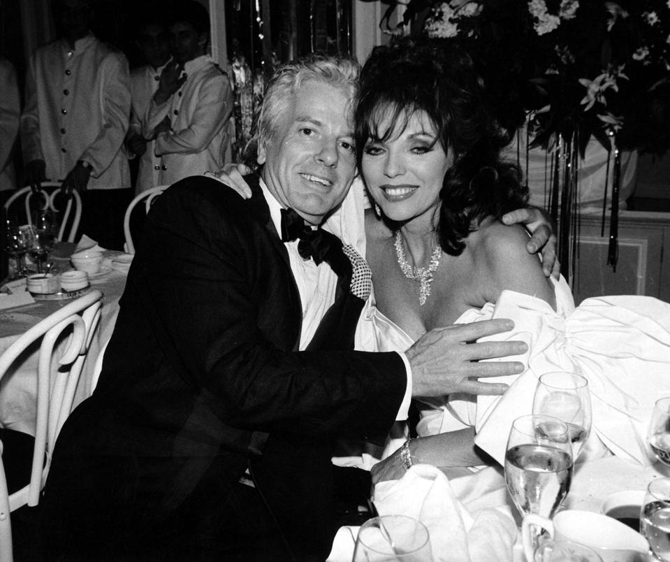 Joan Collins and Nicky Haslam at a party at the Savoy Hotel in London, 1988