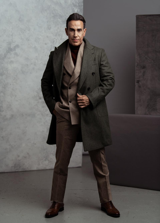 Green Overcoat, Circular Wool Flannel, $599.- https://suitsupply.com/en-us/men/coats/mid-green-overcoat/J778I.html     Navy Turtleneck, Pure Merino Wool, $ 119.- https://suitsupply.com/en-us/men/knitwear/navy-turtleneck/SW1040.html   Light Brown Havana Suit, Circular Wool Flannel, $598.- https://suitsupply.com/en-us/men/suits/light-brown-havana-suit/C6182I-S.html   Brown Oxford, Italian Calf Leather, $249.- https://suitsupply.com/en-us/men/shoes/brown-oxford/FW1106.htmlWardrobe Styling: Jeffrey Ampratwum, Grooming: Stetson Bryan