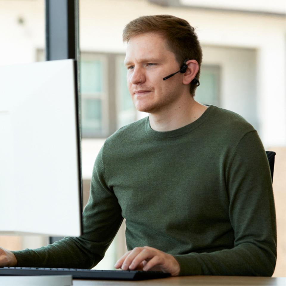 Man wearing OpenComm headset