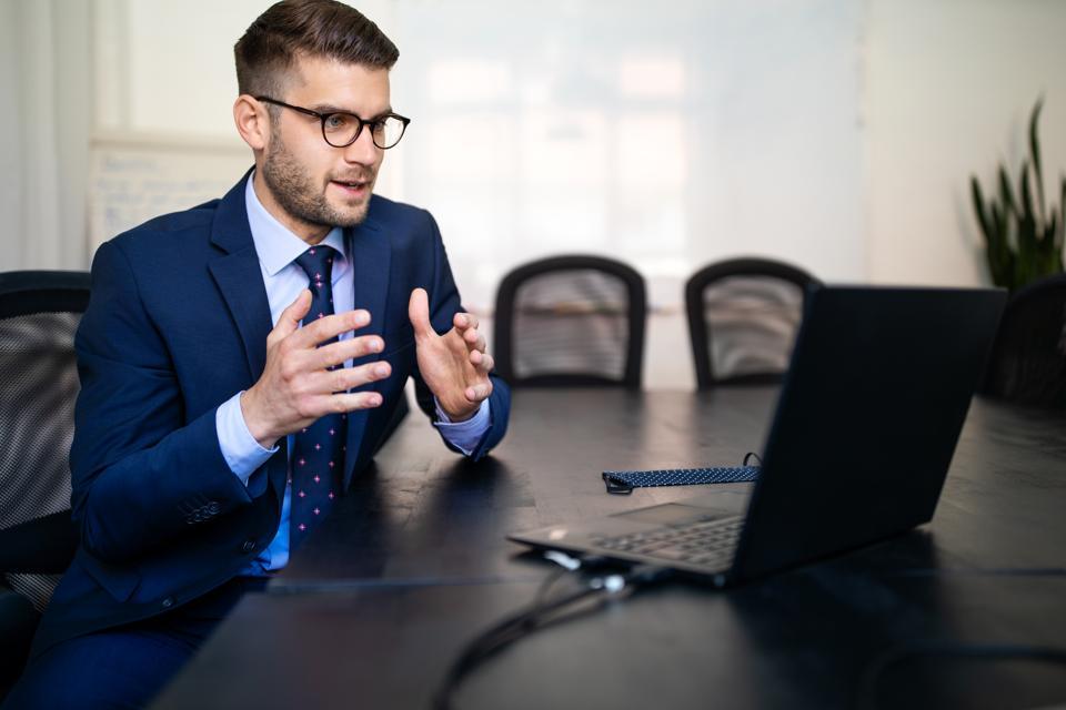 Businessman explaining new plan to team over video call