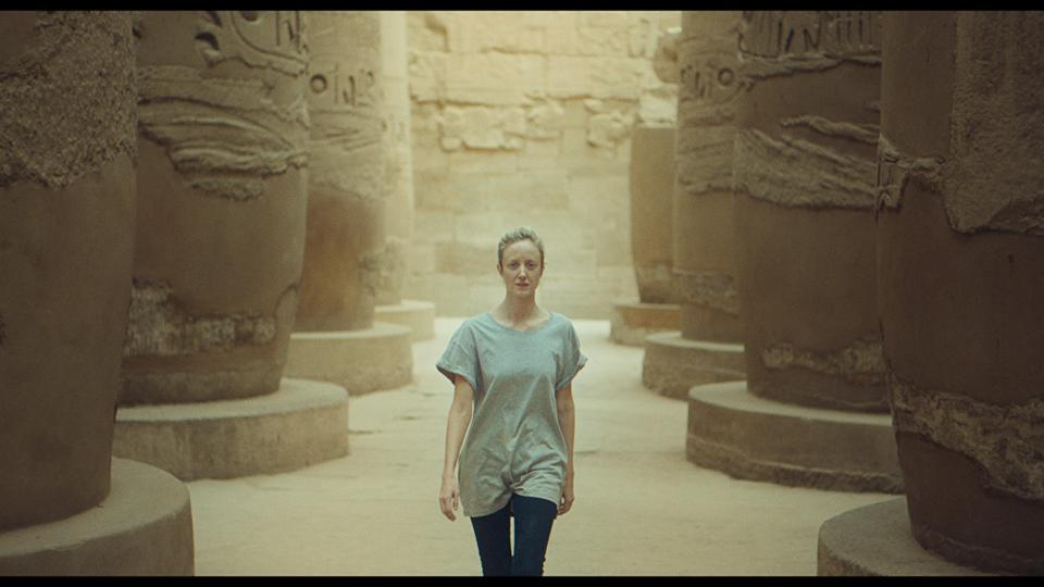 woman walking through ancient Egyptian site