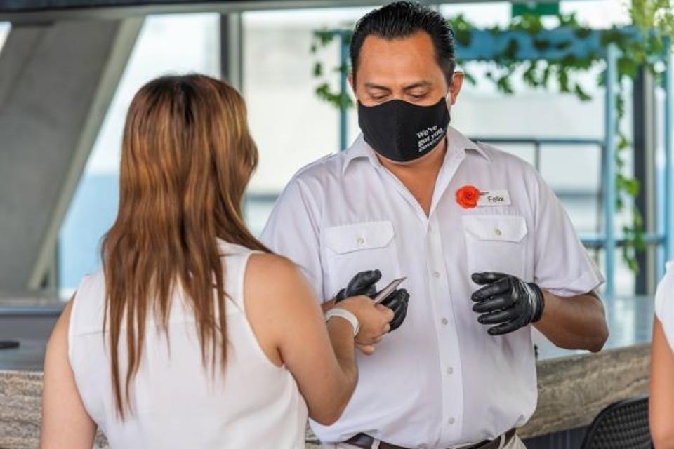 Hilton concierge assisting guest