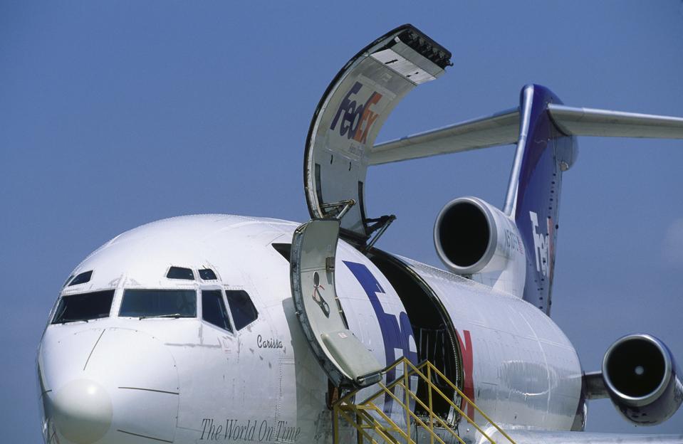 open cargo door on FedEx Boeing 727-100F parked named