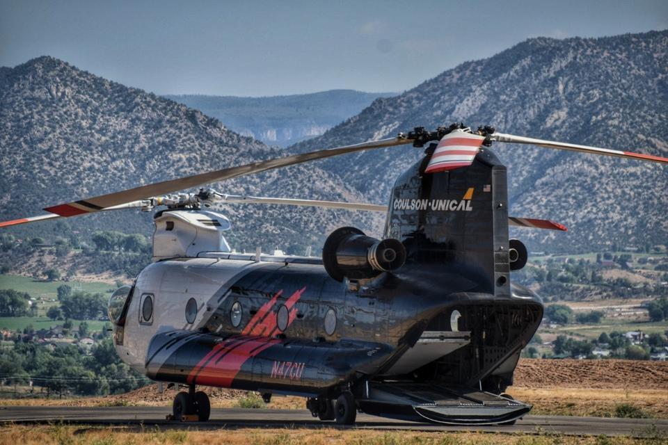 A Coulson CH-47D Chinook helitanker sits on fire alert.