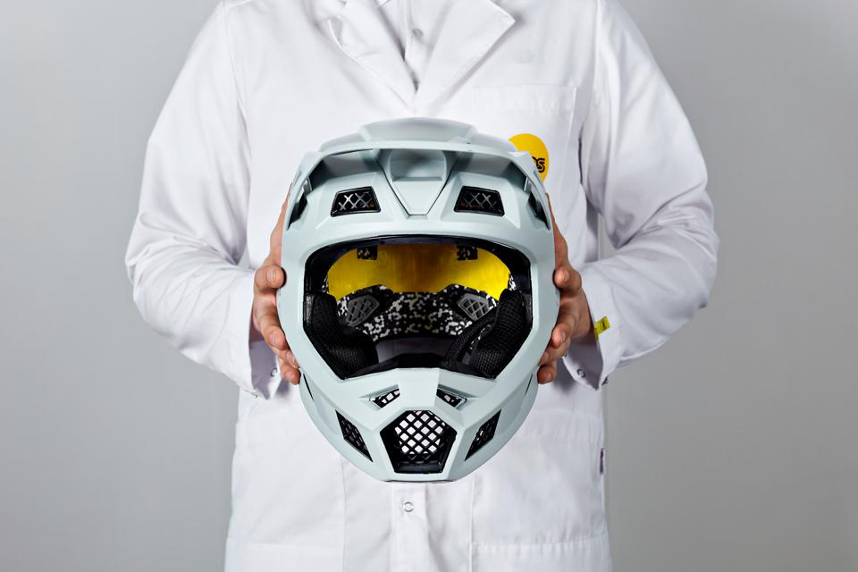 The yellow MIPS liner visible inside a helmet.